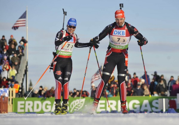 Magdalena Neuner (second leg), left, taps German teammate Alexander Wolf (third leg) in the I.B.U. World Cup mixed relay biathlon competition at the Nordic Heritage Center in Presque Isle, Maine on Saturday, Feb. 5, 2011. The German team took first place in the competition Saturday.