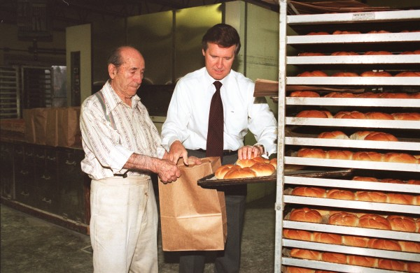 Sen. William Cohen helps his father, Ruby, package orders for delivery throughout Bangor.