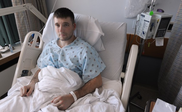 "Chris Dubois of Orono recovers at Eastern Maine Medical Center in Bangor on Tuesday after being rescued from Mount Katahdin on Sunday. Dubois was hiking the Helon Taylor Trail with three friends when a gust of wind blew him off the trail and sent him tumbling over icy rocks. ""It happened within 100 yards of the peak,"" he said. ""The visibility was about 10 feet and we had wind gusts about 70 miles per hour. By the time my friends realized I was not behind them, I was blown way off the trail."" Injured and missing some of his equipment, he descended to tree line where he was able to dig a shelter in the snow. Overnight he gradually lost feeling in his legs and suffered frostbite in his toes."