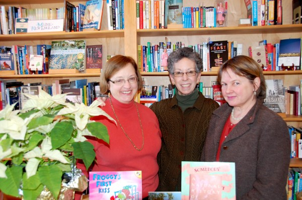 The three founders and co-owners if the Left Bank Bookshop in Searsport stand near a selection of books at the store recently