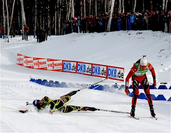 Norway's Emil Svendsen (left) edges France's Martin Fourcade to win the men's 12.5K pursuit in the World Cup biathlon Saturday in Fort Kent.