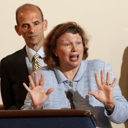 Dr. Dora Anne Mills, seen here with former Gov. John Baldacci, was removed as the head of the MaineCare program on Wednesday.