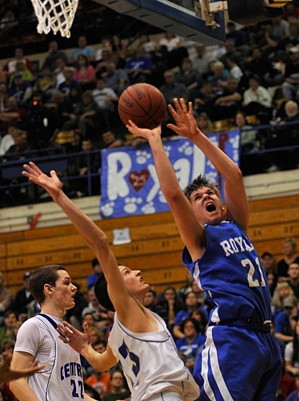 Jonesport-Beals High School's Justin Alley (21) puts up a shot with Central Arrostook's Brendan York and Caleb Kelly, far left, behind him in the third quarter of their Class D Eastern Maine final at Bangor Auditorium Saturday afternoon, Feb. 26, 2011.
