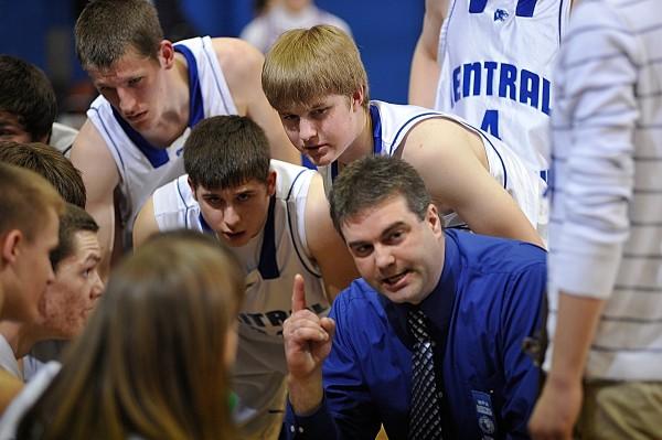 Central Aroostook head coach Tim Brewer huddles with the team during a timeout in the third quarter of their Class D Eastern Maine final  against Jonesport-Beals at Bangor Auditorium Saturday afternoon, Feb. 26, 2011.