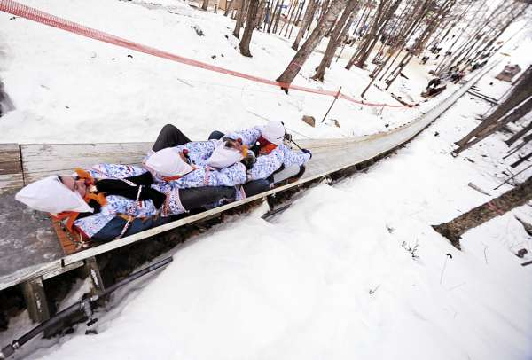 Members of the Royal Dutch National Tobbagan team from Holland compete in the 20th annual National Toboggan Championships at the Camden Snow Bowl on Saturday, Feb.6, 2010. The 400-foot ice covered chute provides thrills with teams hitting top speeds of 40 mph.