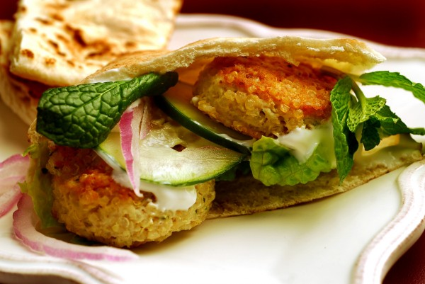 Sprinkled in salads or piled like pilaf, queen grain of the Inca is a delight. Here, quinoa-turkey patties in pita are featured.