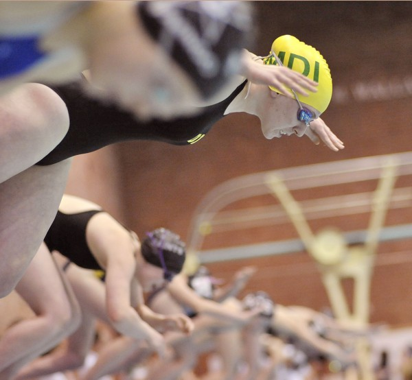 Mount Desert Island's Erin Connery, top, gets a quick start off the block in the 500-yard freestyle event during the Class B state swimming and diving championships Saturday Feb 19, in Orono, Maine. MDI went on to win the state title.