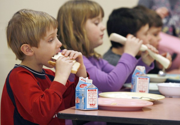 Students eat lunch at Sharon Elementary School in Sharon, Vt., last year. A new $250,000 federal grant will help New England states get more locally raised food into their colleges, schools, hospitals and other institutions.