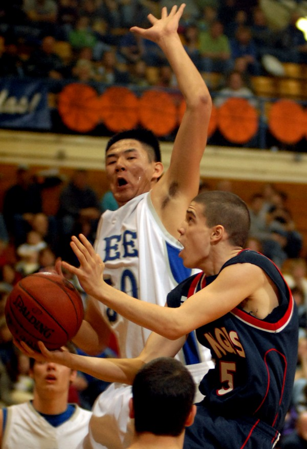 Daniel He of Lee Academy denies Penquis of Milo's Shane Emery a basket in second-half action of their Eastern Maine Class C boys basketball semifinal game Saturday morning at the Bangor Auditorium. Lee won 48-27.