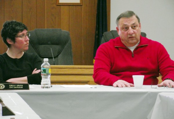 Gov. Paul LePage speaks at Presque Isle City Hall on Friday during a meeting with city councilors and education officials. During the hourlong question-and-answer period, LePage addressed everything from concerns about education to ideas for supporting agriculture in Aroostook County. Councilor Emily Smith (left) watches as the governor discusses his ideas for reducing energy costs.