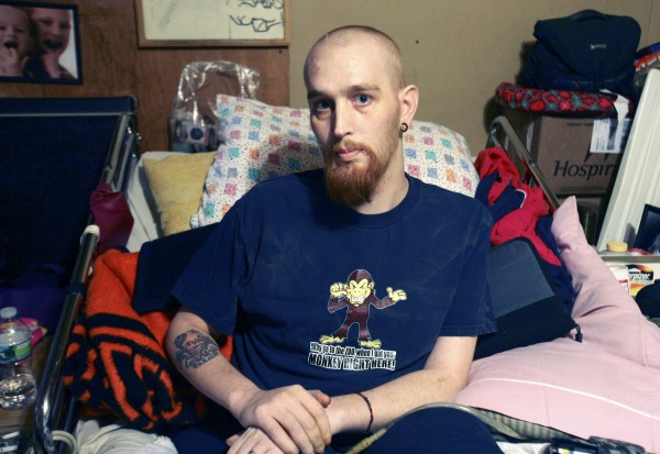 Anthony Napoleone, age 28, of Salina, Kan., lies in his bed in Raymond, Maine  in Nov. 2010.