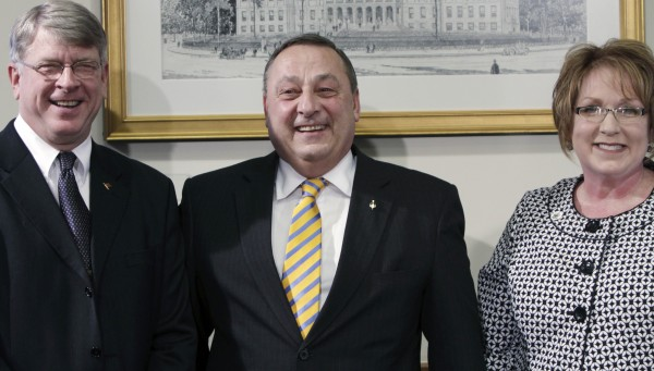 Gov. Paul LePage, center, stands with Cheryl Russell, right, of Chester, and Chandler Woodcock, left, of Farmington, at a news conference in Augusta.LePage announced that Russell has been chosen to become the next Labor Commissioner and Woodcock has been chosen to become the next Inland Fisheries and Wildlife Commissioner.