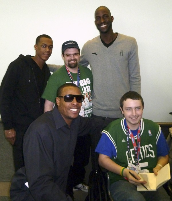 Brandon Higgins (right) and his father, Kevin Higgins, (back, center) are shown during an autograph session with three of the Boston Celtics who played during last weekend's NBA All-Star game in Los Angeles. In the top row are (from left) Rajon Rondo, Kevin Higgins and Kevin Garnett. In the bottom row are team Captain Paul Pierce and Brandon Higgins.