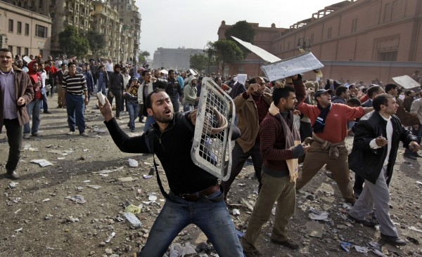 Anti-government protesters throw stones during clashes in Cairo, Egypt, Thursday, Feb. 3, 2011. Egypt's prime minister apologized for an attack by government supporters on protesters in a surprising show of contrition Thursday, and the government offered more concessions to try to calm the wave of demonstrations demanding the ouster of President Hosni Mubarak.