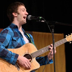 "Wyatt Jenkins of Houlton gives a winning performance of ""Geek in the Pink,"" by Jason Mraz during Saturday evening's Northern Star competition in Houlton. Jenkins was one of three soloists chosen to advance to the finale of the American Idol-like contest in Aroostook County."