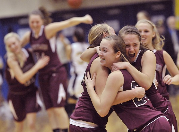 Nokomis' girls' basketball  team players  Taylor Shaw , left,  Kelsie Richards (23), and Kylie Richards (22)  celebrate after their team defeated Medomak Valley in the Eastern Maine CLass B final Saturday, Feb. 26, 2011.