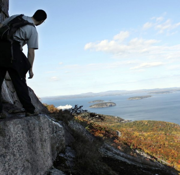 Derek Runnels of Veazie looks out over Acadia National Park and the Porcupine Islands in October 2010 while hiking Precipice Trail, a steep climb of about 1,000 feet up the east face of Champlain Mountain.