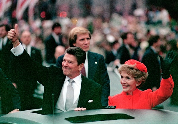 This Jan. 20, 1981 file photo, shows President Ronald Reagan as he gives a thumbs up to the crowd while his wife, first lady Nancy Reagan, waves from a limousine during the inaugural parade in Washington following Reagan's swearing in as the 40th president of the United States. Sunday, Feb. 6, 2011, marks the centennial anniversary of Reagan's birth.