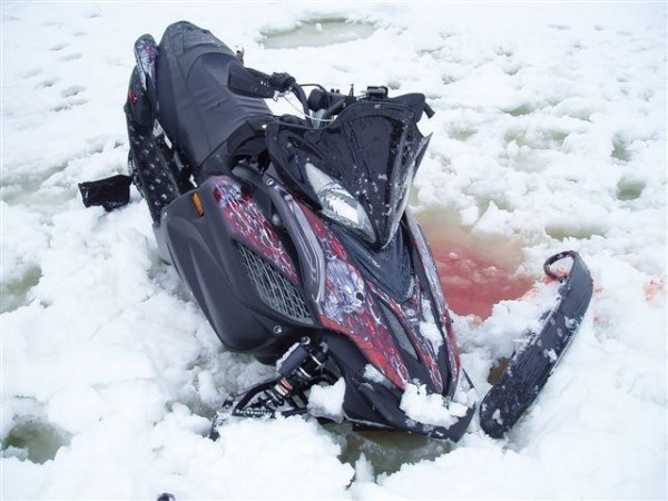 A 38-year-old Massachusetts man was seriously injured while taking his snowmobile out for what his friends called a final spin before loading it onto a trailer to head home.