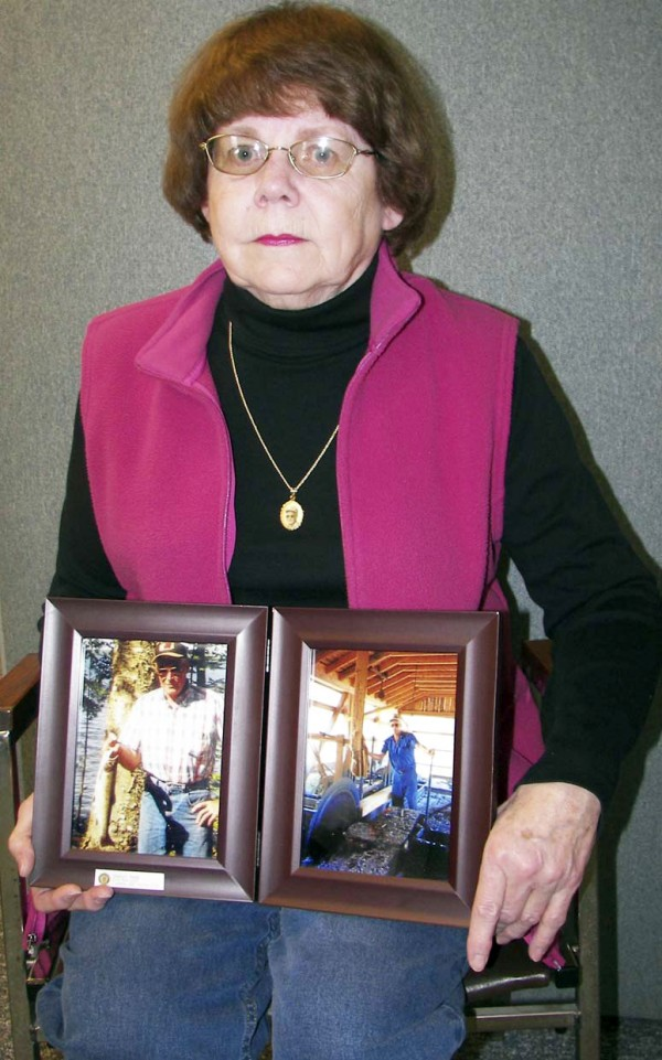 Barbara Smith of Woodland holds two photographs of her late husband Darrel, whose murder remains unsolved after three years. The Feb. 6, 2008, homicide remains an open and active case.