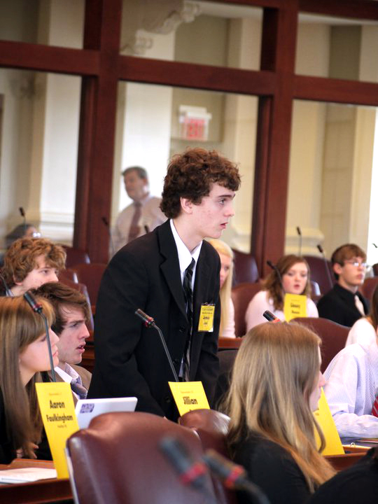 James Jelin, 16, a junior at the Maine School of Science and Mathematics in Limestone, is pictured  last summer taking part in the Maine State YMCA Youth in Government (YIG) program. Jelin will testify on Tuesday in support of a bill he originated, which will amend the laws governing child support if passed.