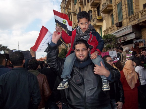Khalid El-Qazzaz and son Abdel-Rahman at Tahrir Square in Cairo, Egypt, on Feb. 6. El-Qazzaz, his wife, Sarah Attia, and their family took part in the protests, which called for the resignation of Egyptian President Hosni Mubarak.