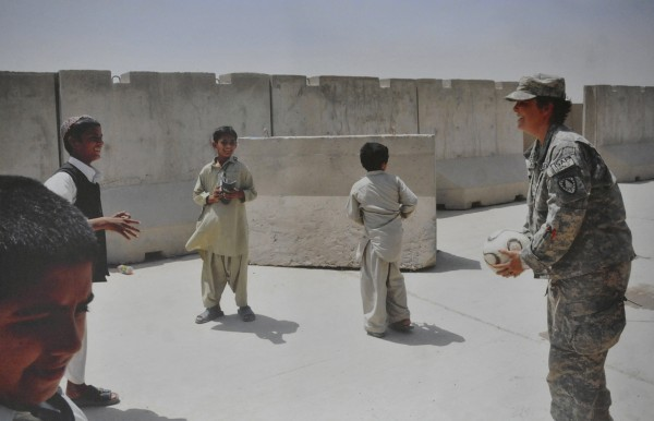 This photo of a soldier playing with Afghan boys was taken by an unkown soldier in Maine's 286th Combat Support Sustainment Battalion, a non-combat arms wing of the Joint Sustainment Command in Afghanistan. It is part of a soldier exhibit at the Jean B. Chalmers Gallery at the Lincoln Street Center for Arts & Education in Rockland.