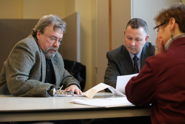 Paul Dumas Jr., left, speaks with Maine State Police Lt. David Bowler, center, and Rep. Sheryl Briggs, of Mexico, Tuesday, Feb. 1, 2011 in Augusta, Maine about a bill sponsored by Briggs to allow people with one arm to have switchblades. Maine law, along with federal law, prohibits possession of spring-loaded blades, but federal law allows for an exemption for a person with one arm.