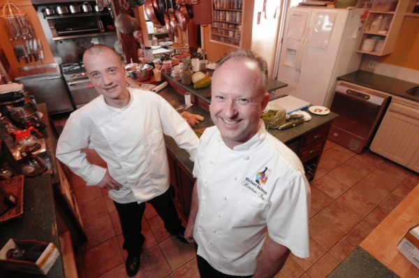 Mike Salmon (right), chef/owner of the Hartstone Inn and Geoffroy Deconinck, new executive chef at Natalies's at the Camden Harbour Inn, stand in the kitchen of the Hartstone Inn in Camden on Friday.