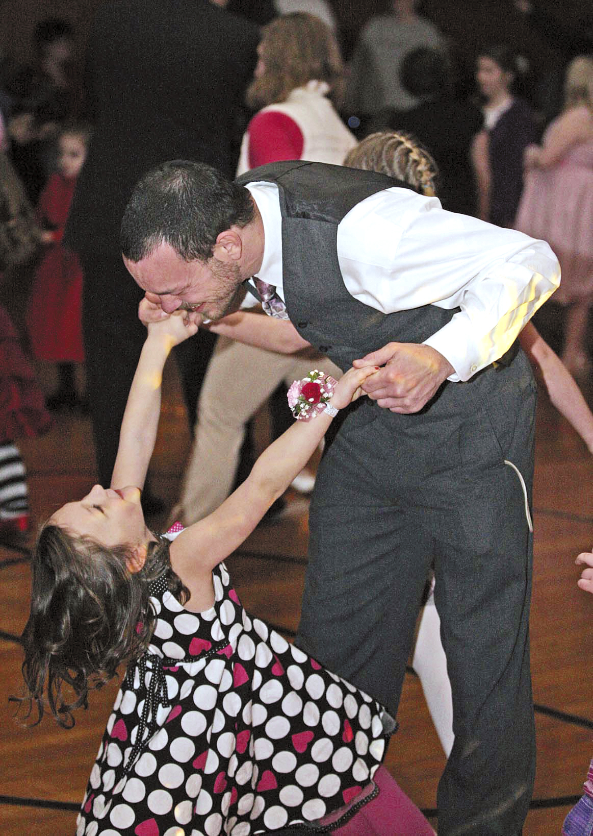 "Jeremy Wedderman of Houlton is all smiles as he dances with his daughter Olivia during the third annual ""Daughter Dance"" held Feb. 4 at Gentle Memorial Building. Sponsored by the Houlton Parent-Teacher Organization, the event was held for girls from Houlton Elementary School and their ""dates."""
