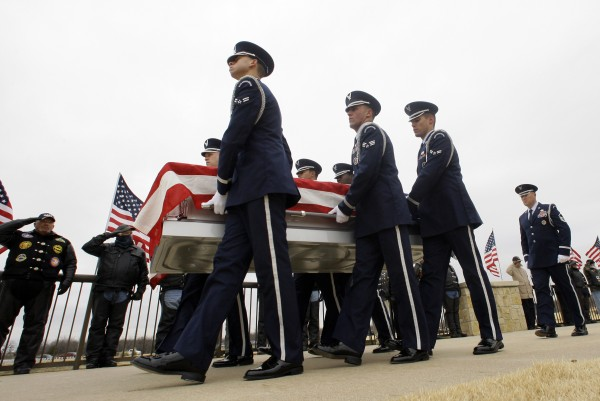Dyess Air Force Base color guard carry the remains of Col. James E. Dennany of Kalamazoo, Mich., and Maj. Robert L. Tucci of Detroit during a burial ceremony at Dallas-Fort Worth National Cemetery, Friday, Jan. 14, 2011, in Dallas.