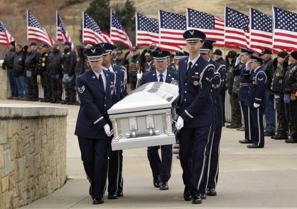 Dyess Air Force Base color guard carry the remains of Col. James E. Dennany of Kalamazoo, Mich., and Maj. Robert L. Tucci of Detroit following a burial ceremony at Dallas-Fort Worth National Cemetery, Friday, Jan. 14, 2011, in Dallas. The military funeral honored the two U.S. airmen from the Vietnam War who had been missing in action for more than four decades.