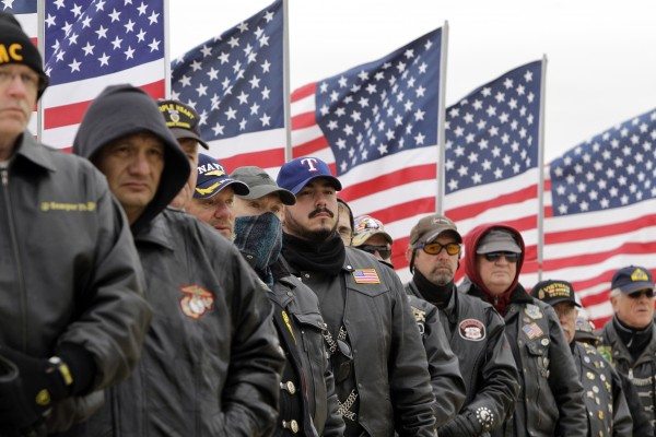 Members of the North Texas Patriot Guard look on during a burial ceremony for U.S. Air Force Col. James E. Dennany of Kalamazoo, Mich., and Maj. Robert L. Tucci of Detroit at Dallas-Fort Worth National Cemetery, Friday, Jan. 14, 2011, in Dallas.