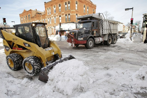 A snow removal crew cleans up the street in the Southie neighborhood of Boston on Jan. 31.