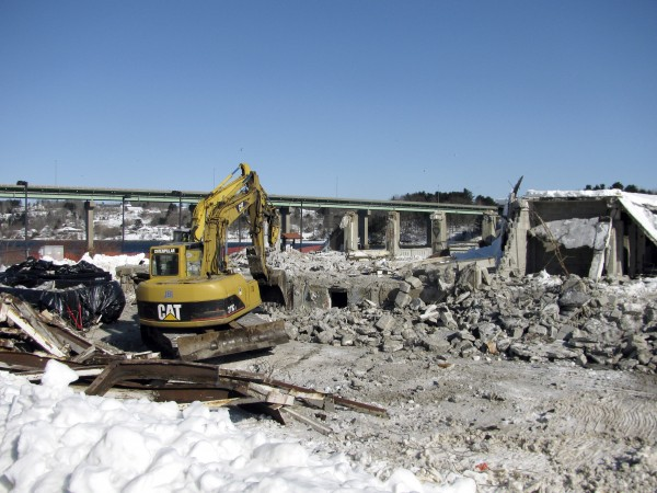 Demolition began this week on one of the dilapidated former Stinson Seafood buildings located off Front Street in Belfast.