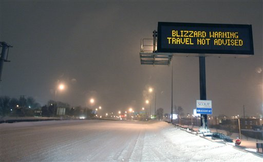 A Kansas City Scout sign warns motorists along I-70 near Kansas City, Mo., Tuesday, Feb. 1, 2011. I-70 was closed from Kansas City to St. Louis because of heavy snow. The area is under a blizzard warning until Wednesday.
