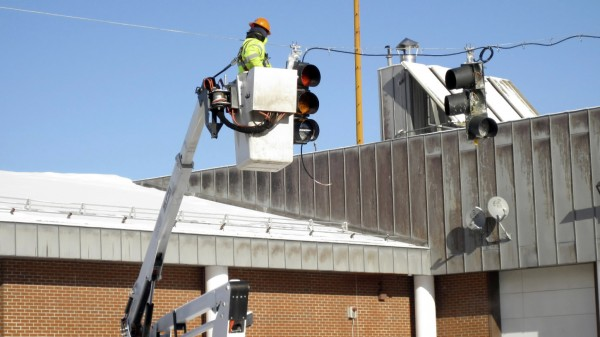 Workers with the Maine Department of Transportation were in Fort Kent this week installing 11 signal lights that will control the flow of heavy truck traffic over the international bridge connecting Fort Kent to Clair, New Brunswick, beginning Friday, Feb. 4. A computerized camera will trigger the system, allowing trucks onto the bridge in 10-minute intervals.