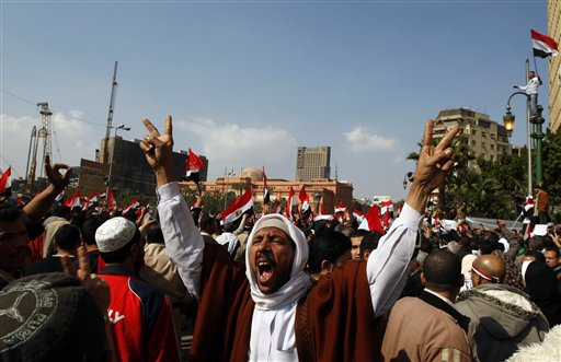 Anti-government protesters chant slogans during the continuing demonstration in Tahrir Square, in downtown Cairo, Egypt,  Friday, Feb. 11, 2011.