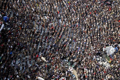 Anti-government protesters make traditional Muslim Friday prayers at the continuing demonstration in Tahrir Square in downtown Cairo, Egypt Friday, Feb. 11, 2011.