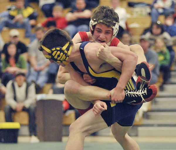 Camden Hills' Thomas Cassidy (right) wraps up Medomak's Stefan Nicholls in their 130-pound match at the Eastern Class B championships held at MDI in Bar Harbor on Saturday, Feb. 5, 2011.