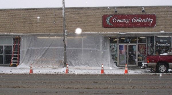 The storefront of Country Collectibles in Presque Isle already was enclosed in plastic sheeting Tuesday morning after a 3 a.m. accident in which a truck slid across Main Street and into the gift shop.