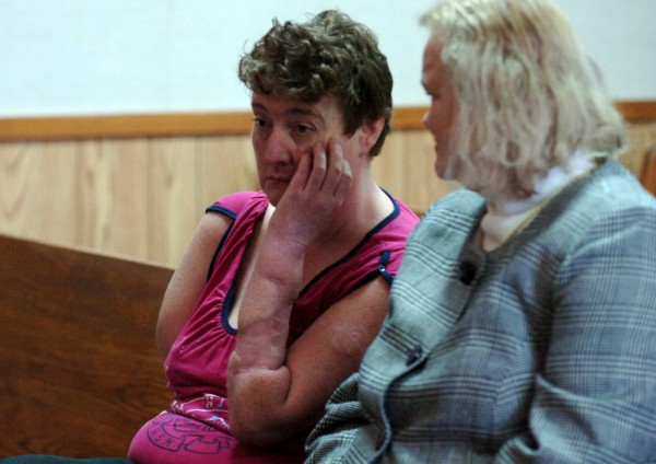 Karen Stewart, on left, sits with her attorney, Patricia Locke, as court proceedings begin in the civil trial of Adam Bemis in Lincoln District Court on Tuesday, February 7, 2011. After being mauled by Bemis's dog in November, Stewart's right arm had to be amputated, and her left arm also sustained considerable injury which required skin grafts from her leg. Bemis failed to appear for the court proceedings, during which Judge Kevin Stitham imposed a fine of $1,000, the maximum allowed by Maine state law. Stitham also imposed restictions concerning Bemis's ownership of any dogs.