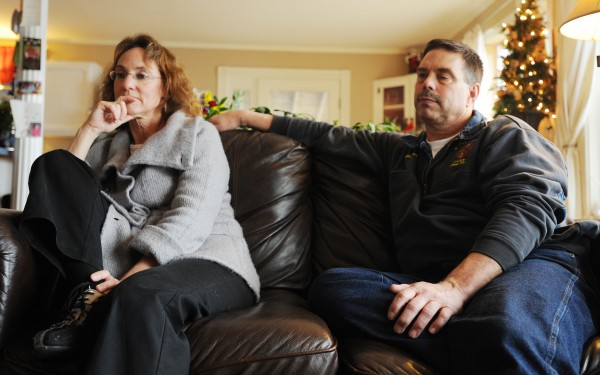 Capt. John Prentiss of the Bangor Fire Dept., right, and his wife Barby sit at their Dedham home discussing John's heart attack in Dec. 2010 while on duty responding to an emergency call.