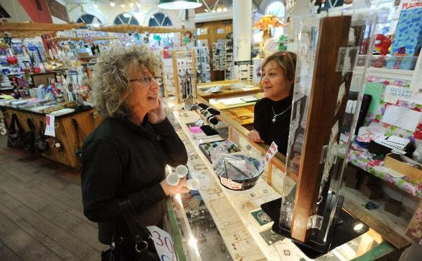Pam Johnson (left) of Bucksport is helped by Grasshopper Shop employee Bianca Borman on Monday, Feb. 14, 2011, at the Bangor store as Johnson shops for a Valentine's Day present. The store will close Monday, Feb. 21, 2011. &quotI have bought a lot of things in here over the years,&quot said Johnson, who is not concerned about the closing as she plans to shop at the Searsport Grasshopper Shop after the Bangor store closes.