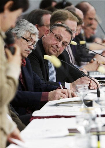 Maine Gov. Paul LePage, center, listens to speakers at a round table discussion on environmental issues, in Augusta, Maine, on Thursday, Jan. 20,  2011.