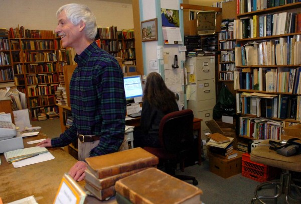 Bill Lippincott, owner of Lippincott Books, is seen in his Bangor store on Monday, Feb. 14, 2011. Although Lippincott will close the Central Street storefront, he will continue to sell books online.