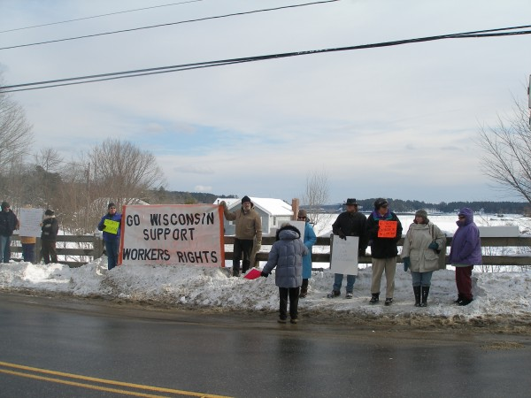 Local demonstrators show support for union members in Wisconsin Saturday during an hourlong gathering at the Mill Stream bridge in Blue Hill.