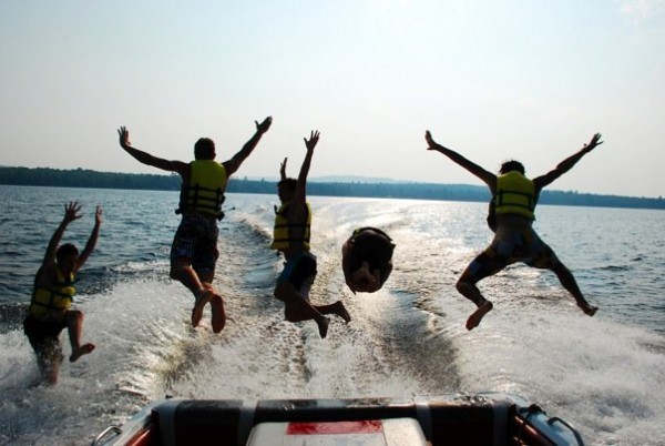 Jumping from a boat are (from left) Josiah Brown, Corey McLean, Steven Ford and Tyler Dunham.