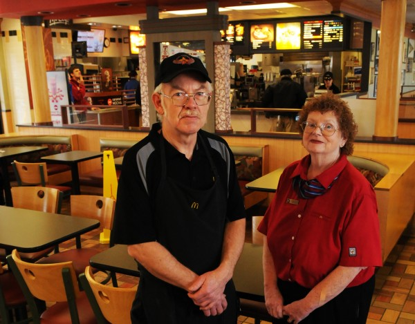 John McPeek, 58, and Mary Jane MacKenzie, 62, both work at the Broadway McDonald's in Bangor and are part of a group of older workers that continue to work into their retirement years. McPeek, a two-year employee, works the grill and McKenzie has been the resturant's hostess for the past 14 years.
