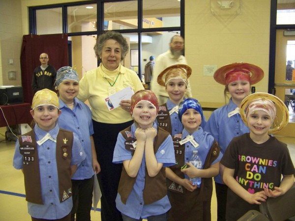 Members of the Mapleton Brownie Troop 1133 had their heads painted to resemble planets on Saturday during the fifth annual Planet Head Day at University of Maine at Presque Isle. Pictured are (front, from left) Delaney Alward, Alexus LaFerriere, Alexis Getchell, Amanda Winslow, Jenna Mountain, (back) Louise Calabrese of C-A-N-C-E-R, Bethany Baker and Katelyn Amero. (Photo courtesy of the University of Maine at Presque Isle)